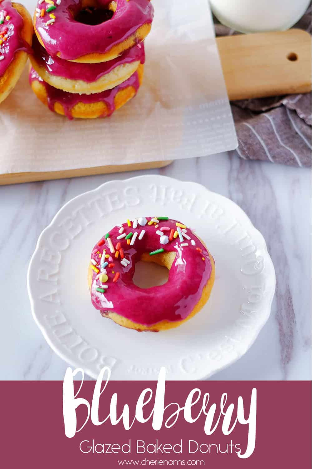 Moist and cakey baked donuts with sweet blueberry glaze! Enjoy this tender cake-like baked donuts on its own, with dusted icing sugar, or with the sweet glaze. via @cherienoms